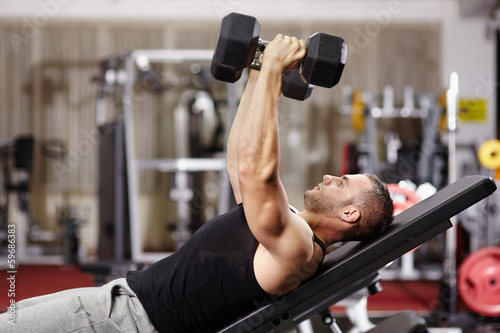canvas print picture Athletic man working his chest