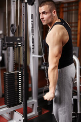 Athletic man pulling heavy weights