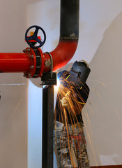 Welder worker fixing industrial construction plumbing pipelin in