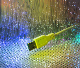 USB plugs closeup with fiber optical background