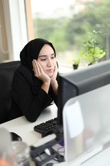Young attractive Asian Arabic female corporate worker