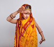 child in traditional Indian clothing and jeweleries dancing