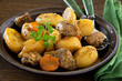 Roast pork and potatoes with spices.