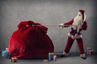 Santa Claus pulls a huge bag of gifts