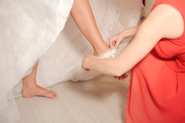 Putting on Wedding Garter