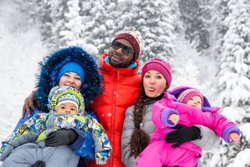 Happy Family with children in ski suit in snowy winter