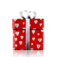 A gift for the holiday in the red packaging with hearts