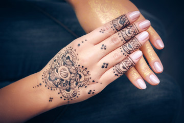 image showing isolated hand of an Indian bride with herbal heena