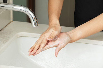 Washing hands with soap