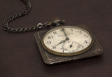 Old worn pocket watch