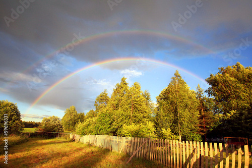 Rainbow over forest and field