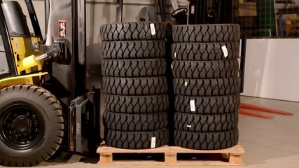 Forklift truck move a pallet with forklift truck tires