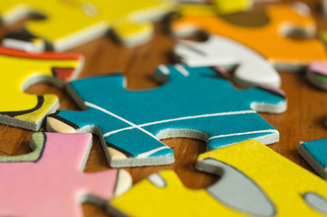 The scattered slices of a puzzle close up