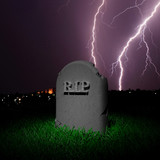 RIP tombstone in grass and dark background with thunders