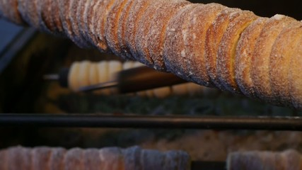 Traditional sweet dough baked on the grill, Christmas Trdelnik