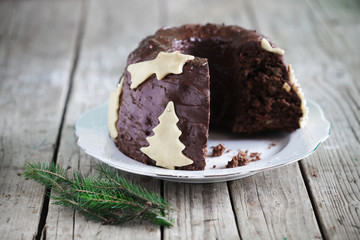 Chocolate gugelhupf cake with marzipan, christmas tree