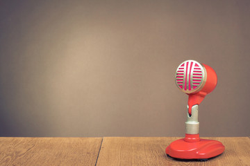 Retro red microphone on table for background