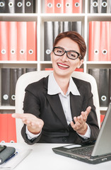 Business woman smiling and gesturing welcome