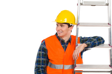 Smiling construction worker with ladder.