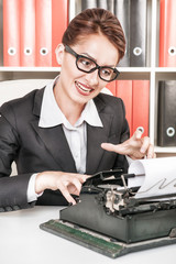 Crazy business woman working with typewriter