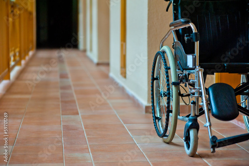 empty wheelchair in hospital corridor
