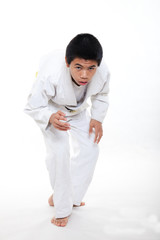 Young asian teen boy doing jiu jitsu martial arts