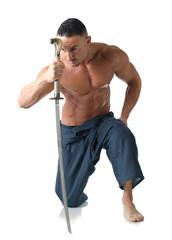 Muscular man kneeling shirtless, with japanese sword