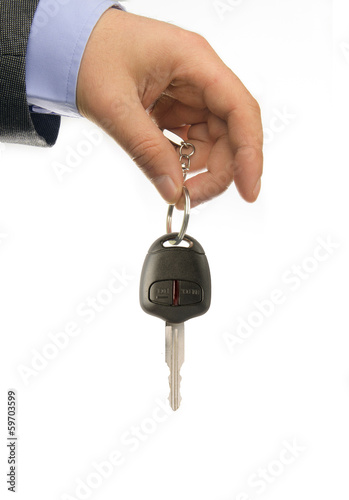 business man holding car key, close-up