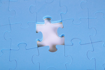Last piece of jigsaw puzzle, close-up