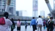 People walking in city, defocused