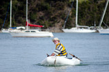 Man sails an inflatable boat