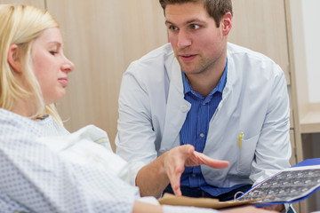 doctor talking with female patient in a hospital