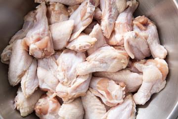 Chicken wings in metal bowl