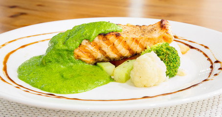 salmon steak with pesto sauce