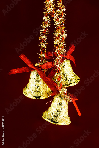 festive bells with Christmas holly on red background
