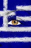 Greece flag painted on woman face