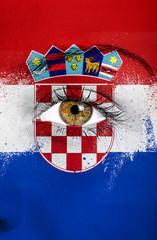 Croatia flag painted over female face