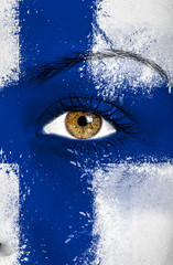 Finland flag painted over female face