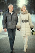 man and woman walking on the street in winter wedding