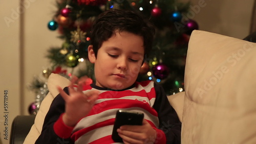 sweet child using and playing smartphone