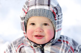 happy baby with rosy cheeks in winter