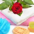 Towels, soap and sponges isolated on white background
