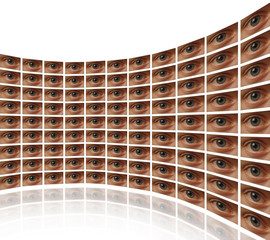 Curved wall of video screens with eyes