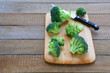 broccoli florets on the kitchen board