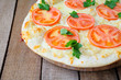 round pizza with tomatoes