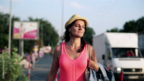 woman walking along the city street