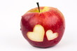 Two hearts on the fresh apple, a Valentines Day theme