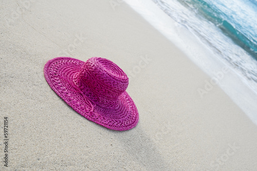 Pink Straw Hat on a Sandy Beach in the Caribbean