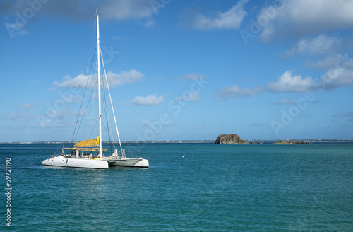 View of a Catamaran and Creole Rock from Grand Case Beach
