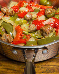 Close-up of Italian sausage and peppers in pan